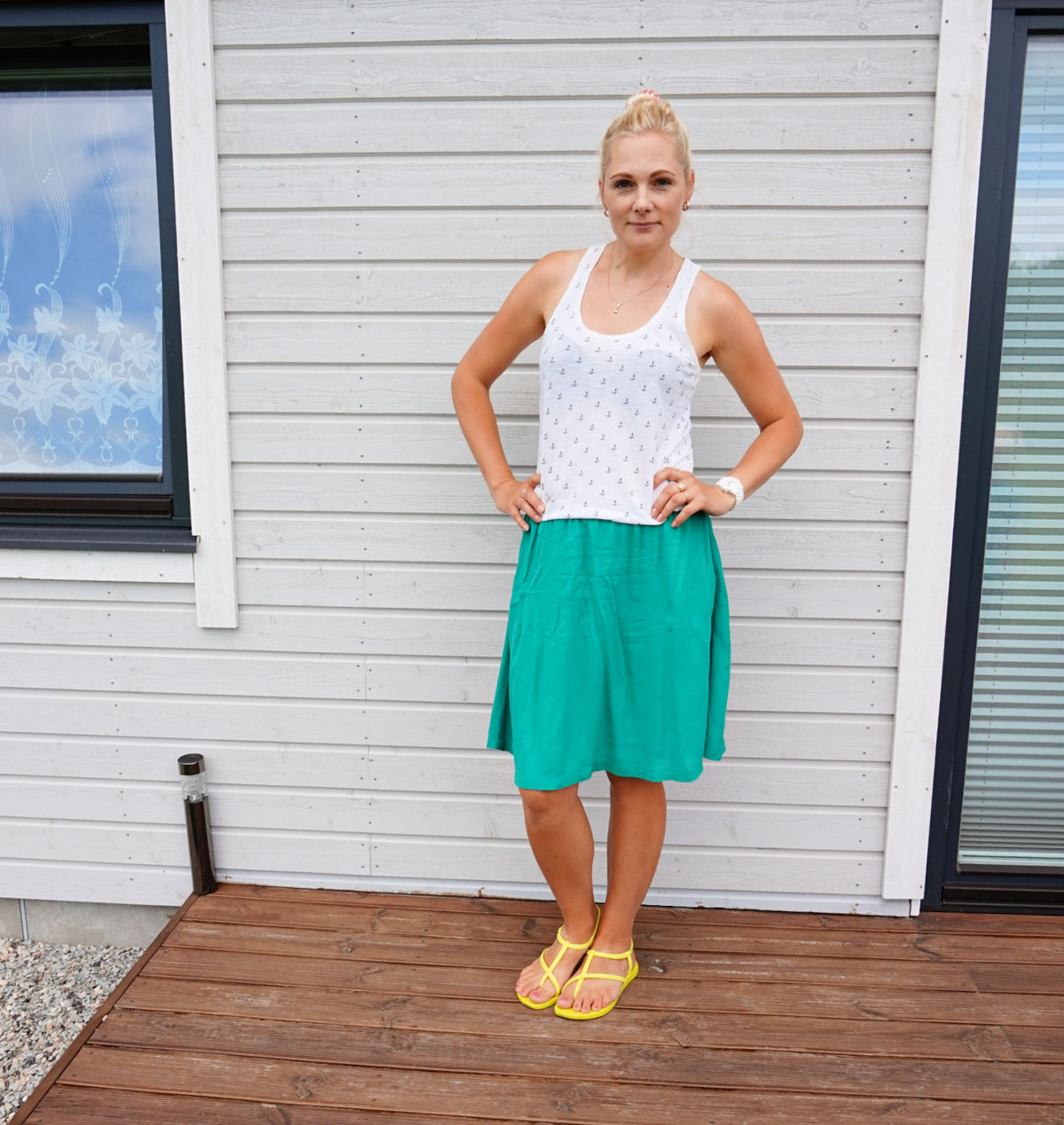 Simple summer outfit green skirt and white anchor print racerback tank top, yellow sandals.