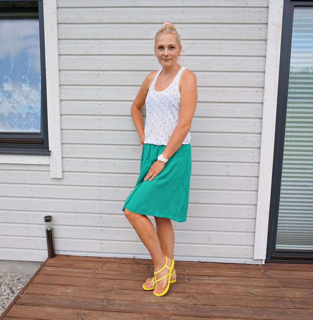white anchor print top, green midi skirt, yellow strappy sandals, white watch