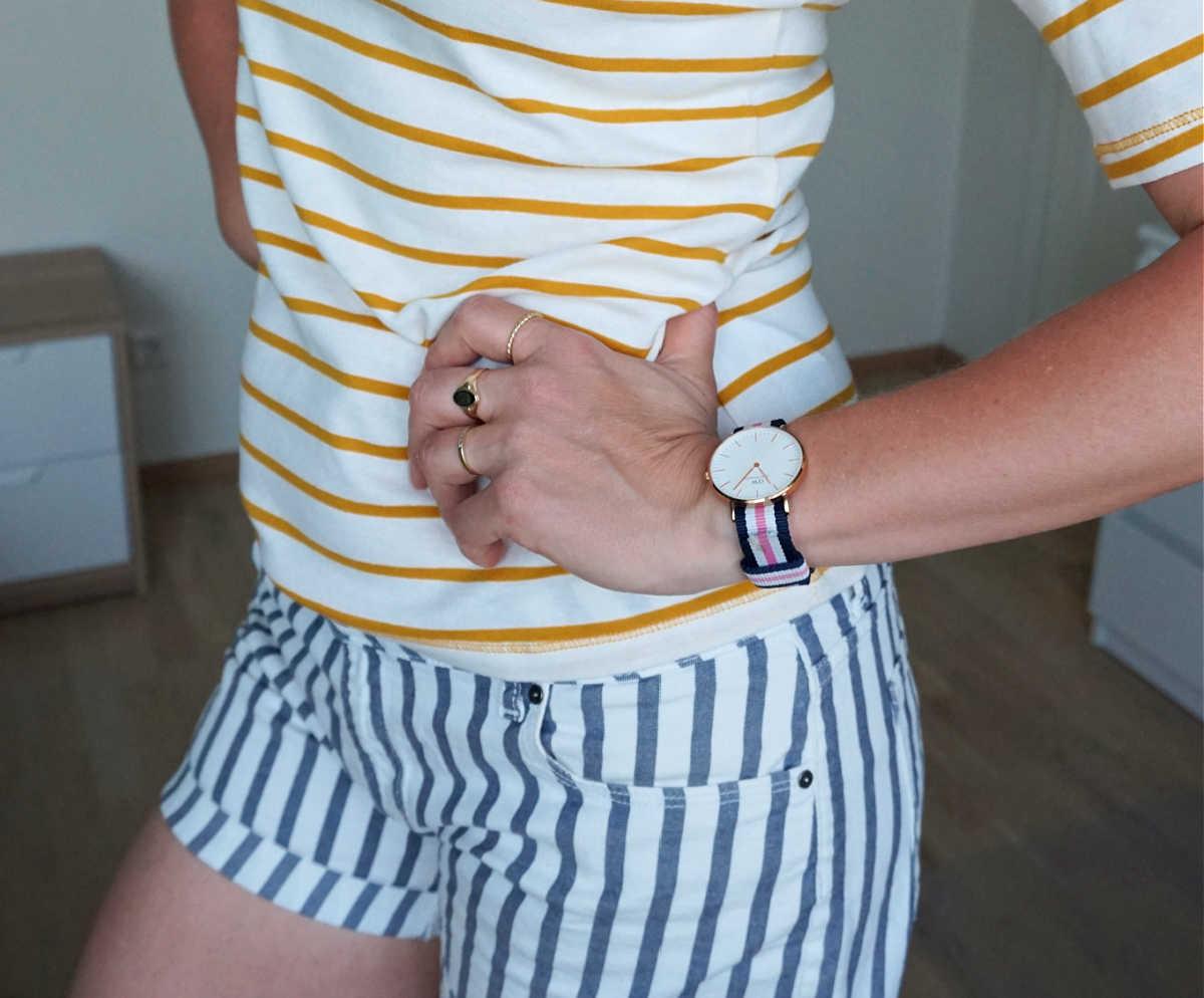 yellow & white striped tee, blue & white striped shorts.
