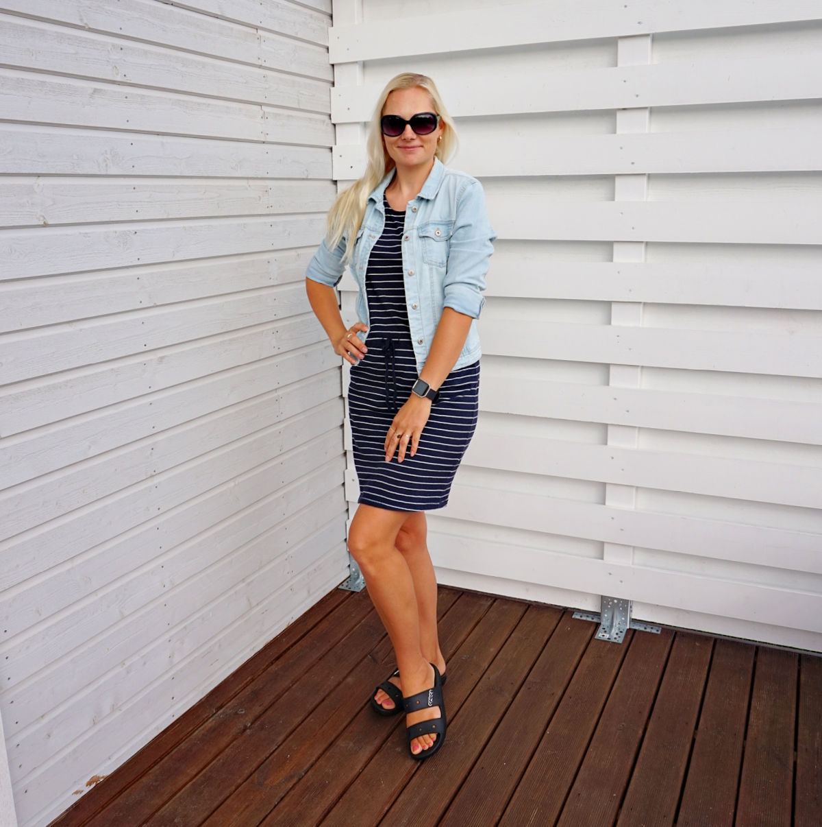 Striped dress and denim jacket outfit