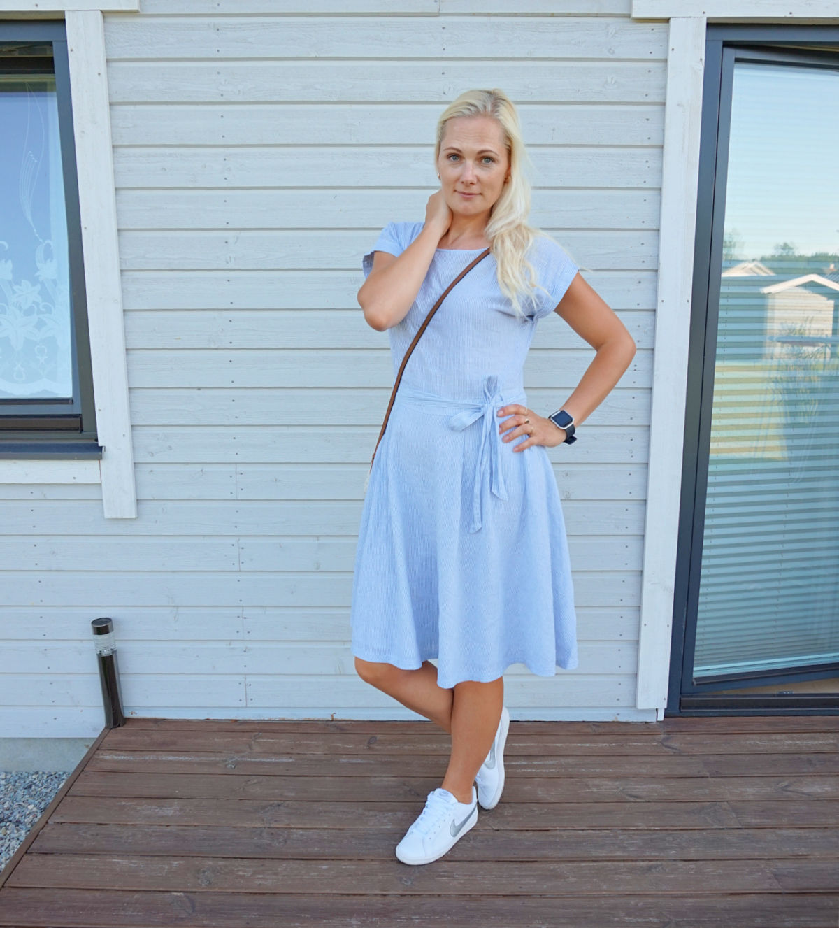 Striped fit and flare summer dress paired with white trainers