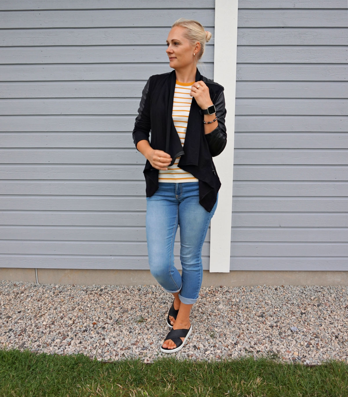 Simple casual outfit - skinny jeans, slip on sandals, striped t-shirt, leather jacket